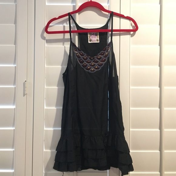 Free People soft tank Dark blue, soft, lightweight, beautiful beading at neckline. Flares out a little at the bottom. Pair it with some jeans or denim shorts  Small rip at the bottom of zipper on the side, price reflects damage. Free People Tops Tank Tops