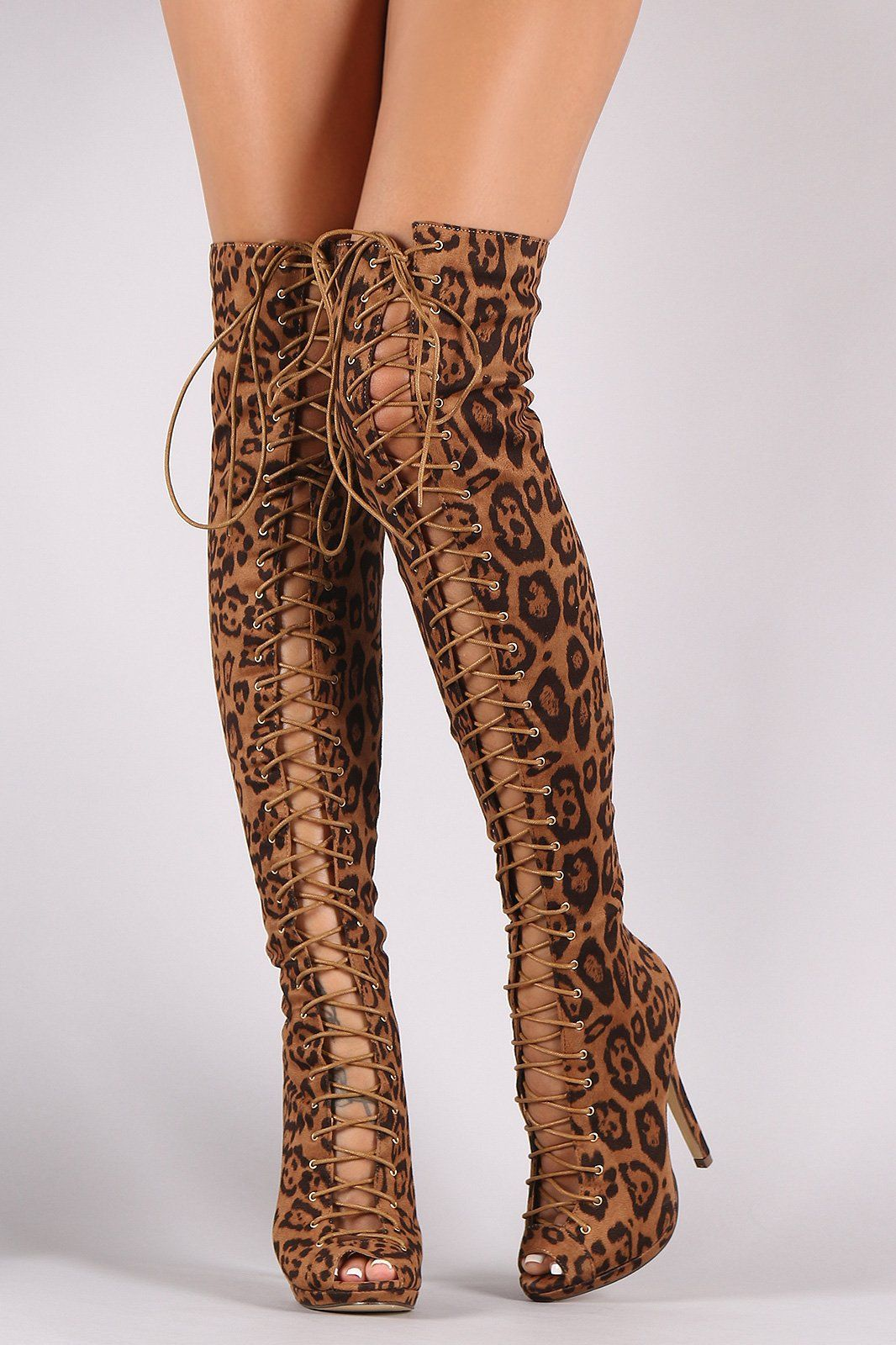 8a75d59be5e2 These striking over the knee boots feature a leopard print vegan suede