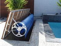 Hideaway Roller With Timber Decking On Opening Lid By Elite Pool Covers
