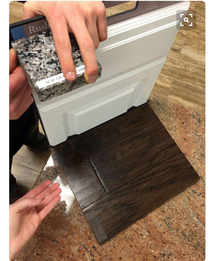Caledonia Granite With White Cabinets And Dark Hardwood Floors