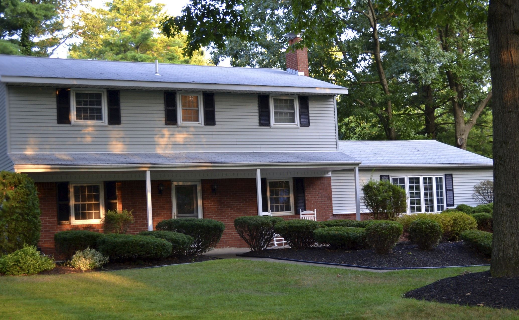 Black Roof Cream Siding Red Brick Google Search Brick Siding Exterior House Colors Shutters Exterior