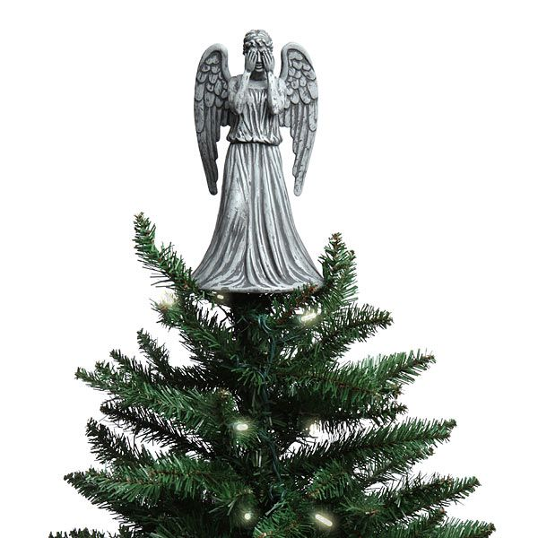 dont even blink or this doctor who weeping angel christmas topper will get you its okay if your christmas light blink as long as you