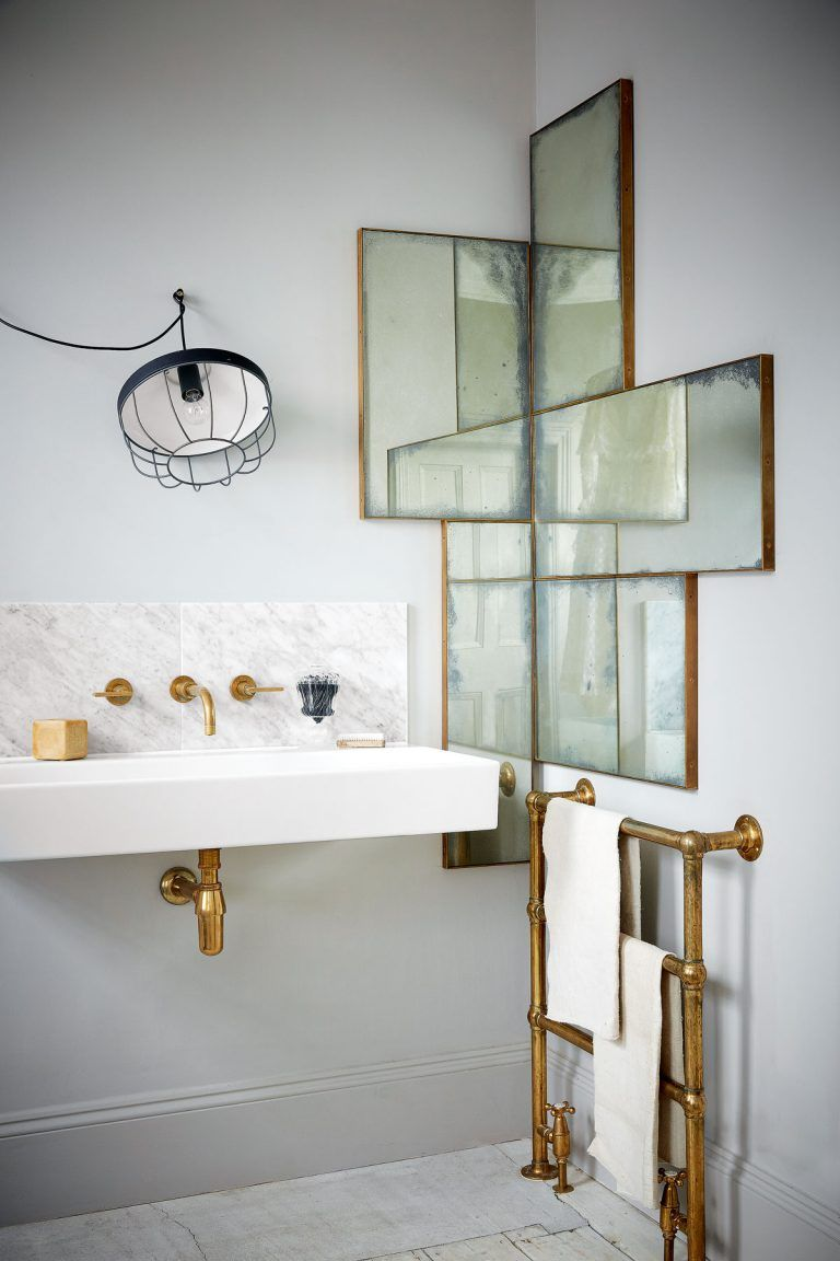 For  touch of urban glamour in your bathroom add foxed glass with an off beat arrangement brass edged mirrors the distressed towel rail and also decorating trend bathrooms decor rh pinterest