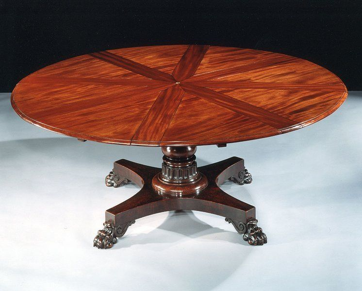 An Expanding Circular Dining Table By Robert Jupe