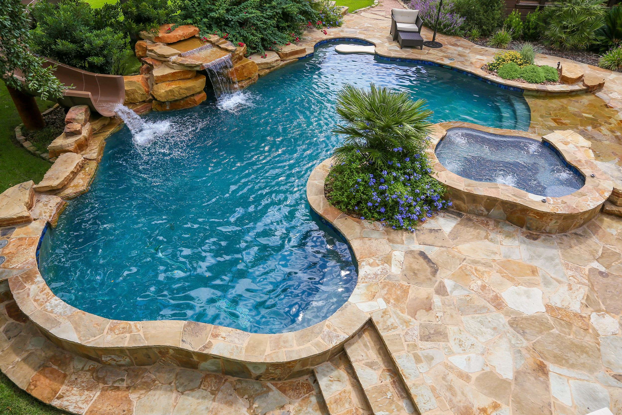 Modern Pool Designs With Slide beach entry swimming pool with a slide and waterfall | backyard
