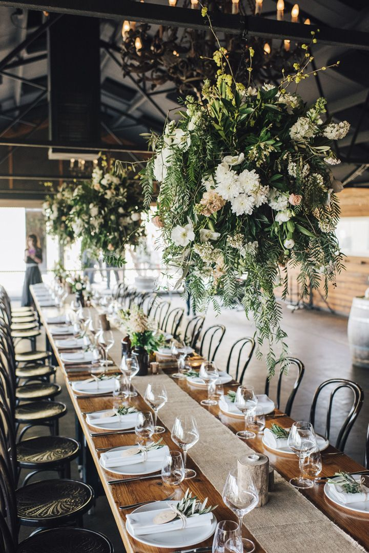 Rustic wedding table setting with florals hung from ceiling | itakeyou.co.uk #wedding #rustic #rusticwedding #barnwedding #vineyardwedding #realwedding #weddingphotos