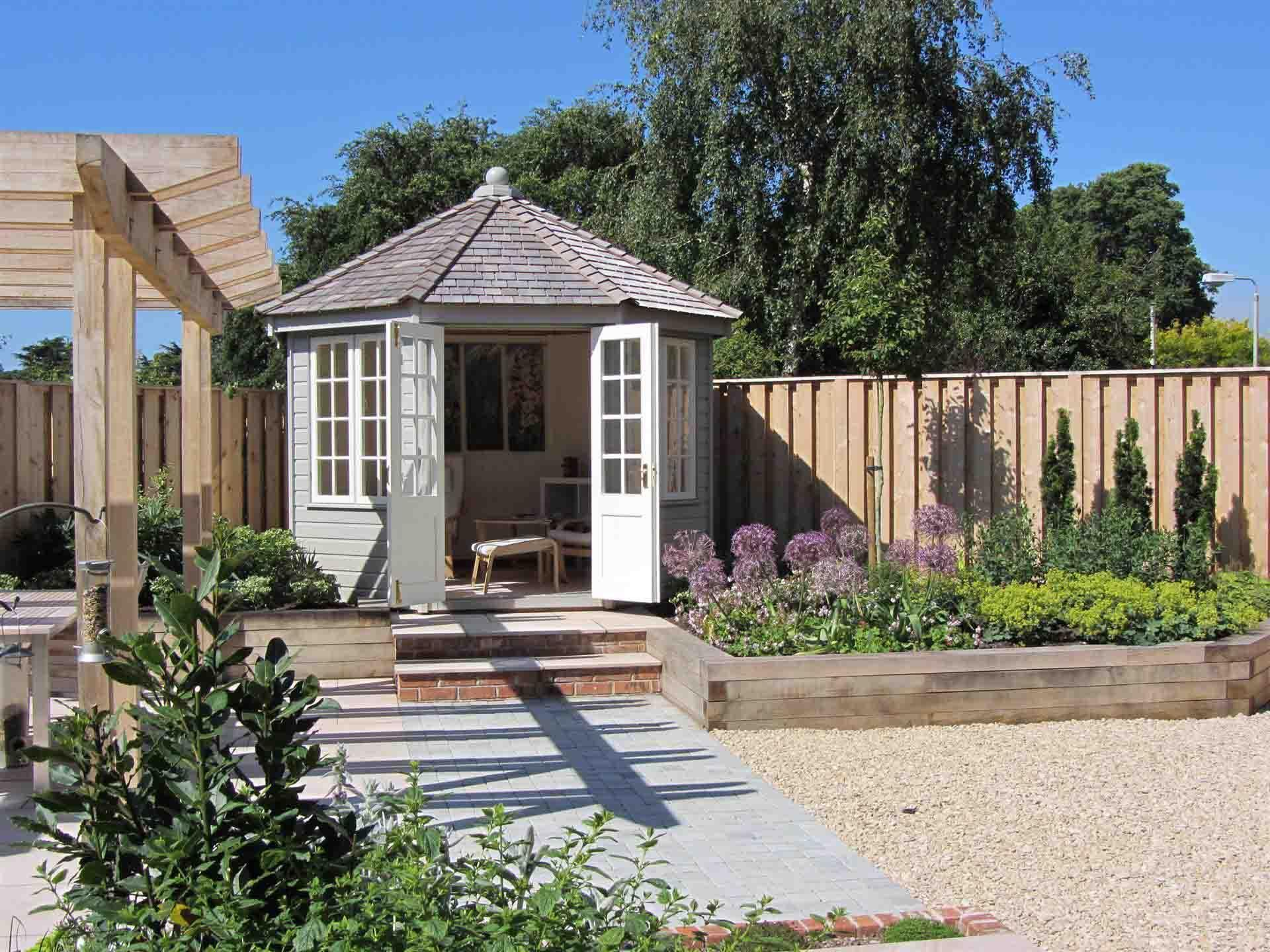 view to summerhouse in gloucestershire garden by chameleon design