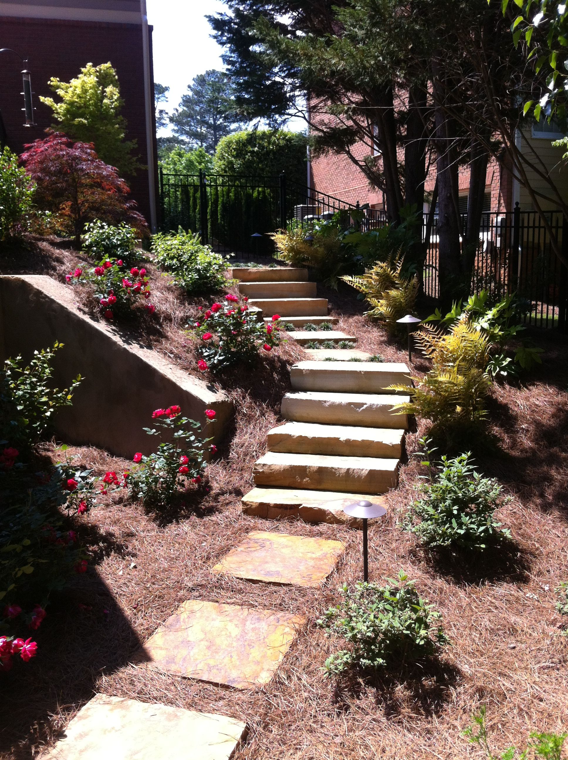 Stone staircase and landscaping.
