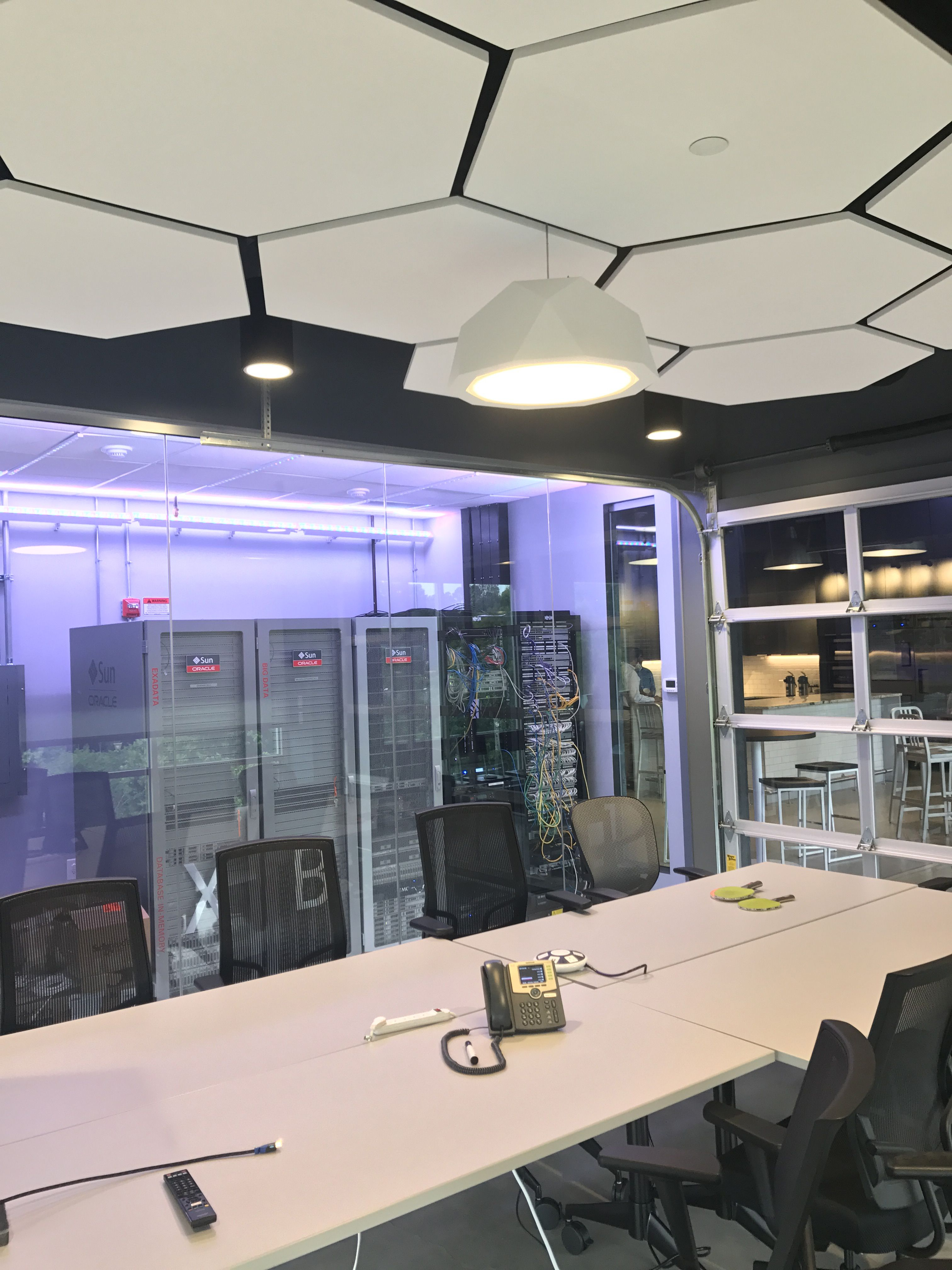 Training Room With Hexagonal Ceiling Tiles And Garage Door Feature