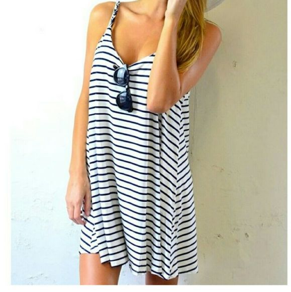 Loose fitting navy and white striped dress Adorable dress, lightweight swimsuit material in navy and white. Loose-fitting, marked L, but would fit XL as well. Make offers or bundle to save 20%! Dresses Mini