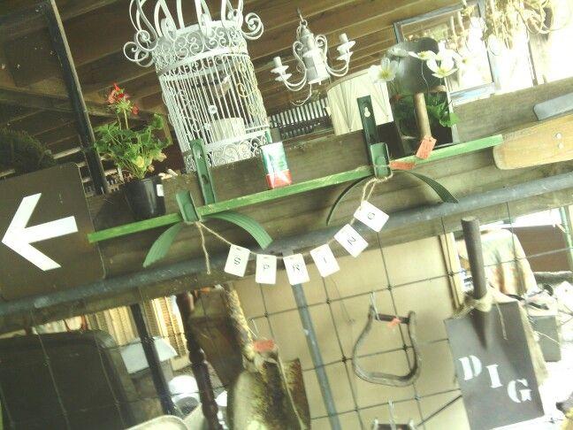 Hose reel shelf by Weltha's Vintage Market.