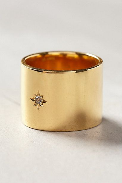 The combination of the wide gold band and the delicate diamond detail make this ring to die for!