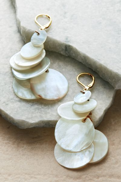 From the sea to you, a cluster of multi-sized discs of luminous mother of pearl dangles from a gleaming chain finished in 22K Gold-plated. Because of natural characteristics, each is one of a kind. Oceano Earrings #1AU18