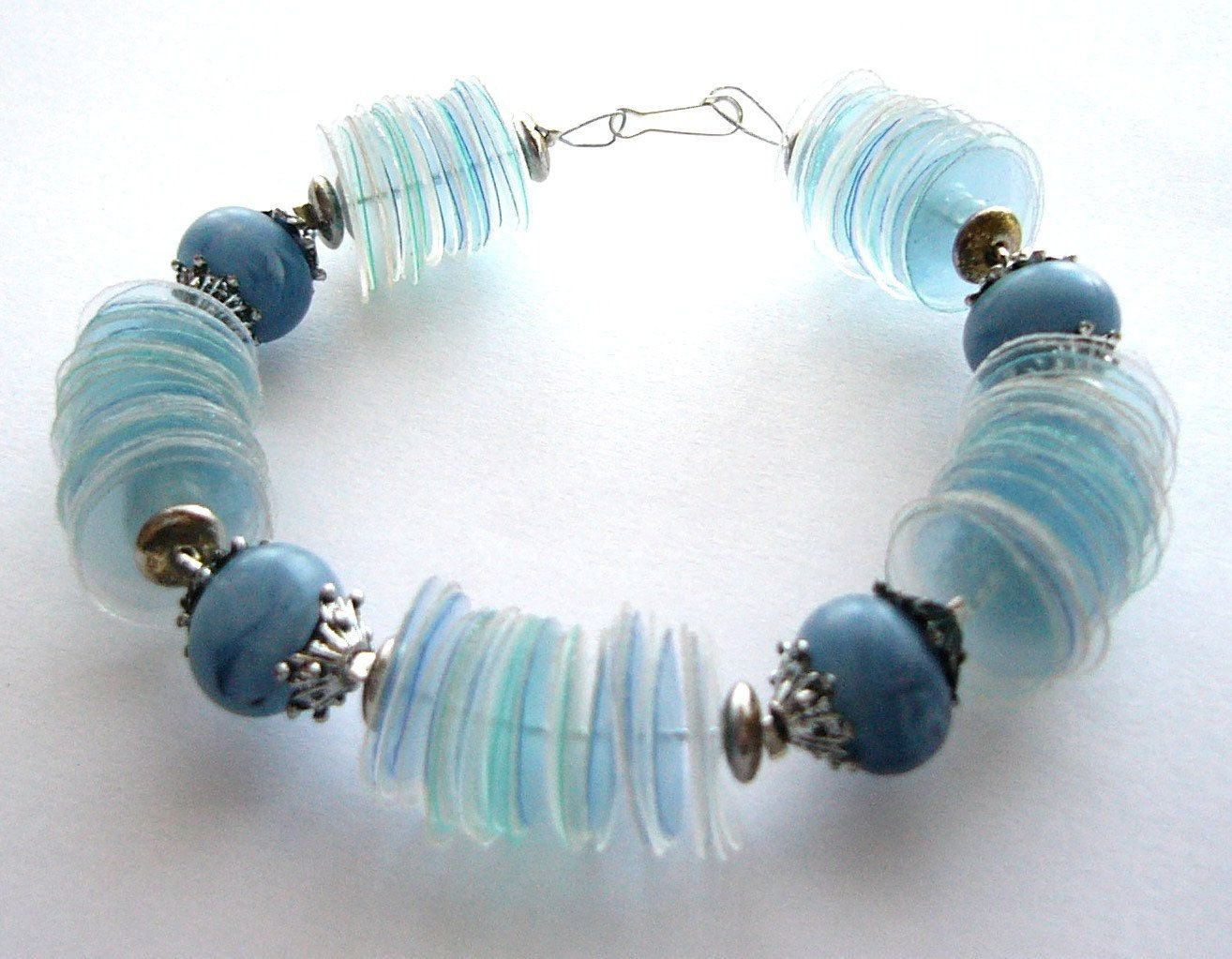 Upcycled blue bracelet made of recycled plastic bottles with blue ...