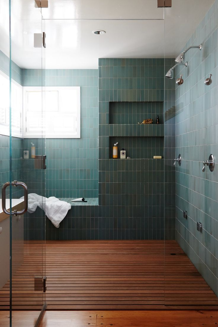 Photo of modern green tile and wood slat floor in large master bathroom shower | modern s…