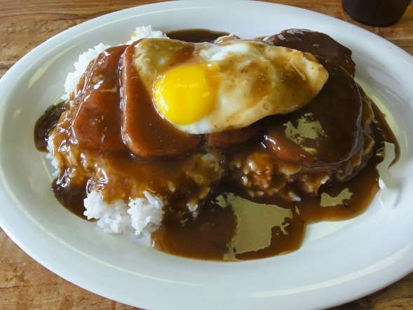 Loco moco, the ultimate Hawaiian comfort food, is definitely not for the faint-hearted: It's a mountain of rice under a floppy hamburger patty, topped with an egg and doused in brown gravy. Delicate? Not a chance. Delicious? Very. Though it's traditionally served as a breakfast dish at diners and mom-and-pop eateries, nowadays you'll find it everywhere from McDonald's to fine-dining restaurants. Get it like a true Hawaiian(MOST ARE WHITES)..LOL.. and throw in a couple slices of fried Spam.