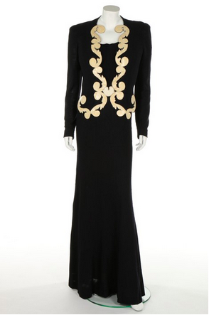 Slideshow:10 Artsy Vintage Dresses to Acquire at Auction June 23 - June 19, 2015 - A rare and important Schiaparelli midnight blue 'Rococo' scroll appliqué slubbed silk jersey evening ensemble (Summer 1937), with Dali-esque lips buckle at the waist. Estimate: £20,000 - £30,000. Kerry Taylor Auctions, Passion for Fashion sale, London, June 23