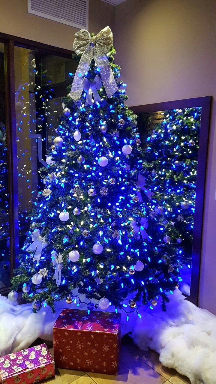 White Christmas Tree With Blue Lights.Christmas Tree With Blue Lights And White Ornaments