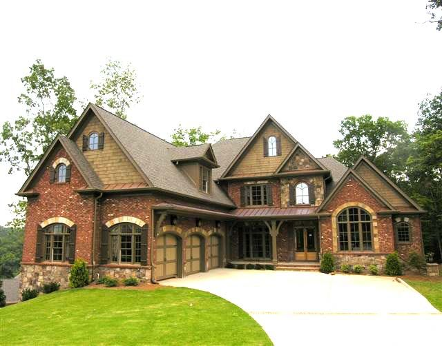 Brick and stone and shake shingle combination house for Stone and cedar homes