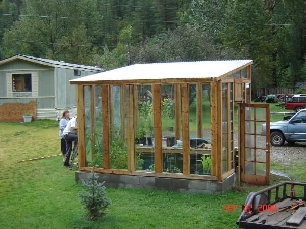 We made this greenhouse from pallets and recycled glass