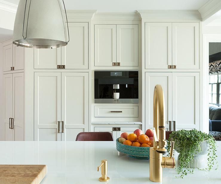 Floor to ceiling cream shaker cabinets in a transitional ...