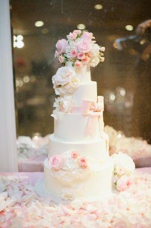 A beautiful five tier round fondant wedding cake. Cake by Vanilla Bake Shop and photo by Hazelnut Photography, via Elizabeth Anne Designs.