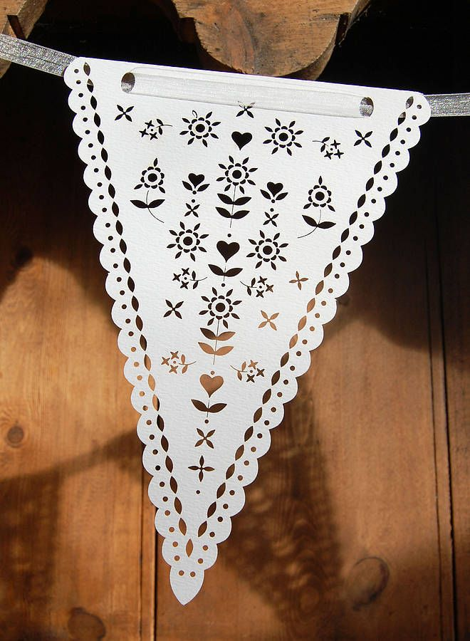 Beautiful laser cut bunting!Our beautiful laser cut bunting is cut from a beautiful white card. It comes in packs of six flags for you to hang with your own string or ribbon. Perfect for decorating a venue, for garden parties, weddings, vintage tea parties or as decorations in a child's bedroom. Add your own string, ribbon, gingham or strips of liberty fabrics to change the look of your bunting for each occasion.Cut from 300gsm, acid free card. Each flag measures approx. 14cm x 20cm.