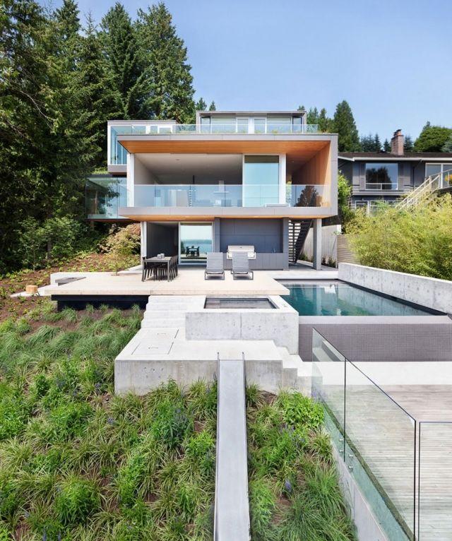 modernes haus steilhang pool beton terrasse glas geländer | Häuser ...