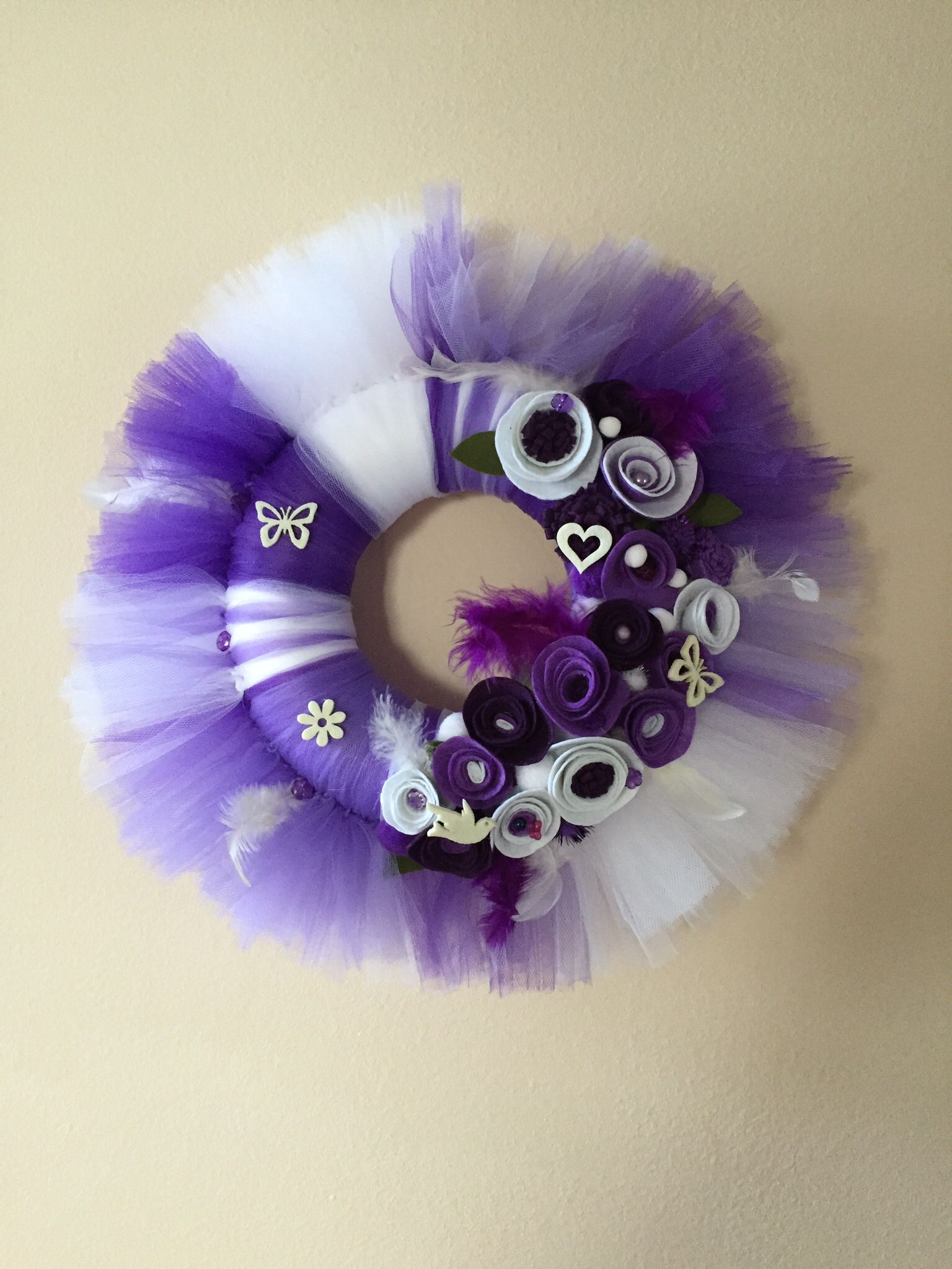 A nice purple-white tulle wreath. With handmade felt flowers, feathers and little butterflies.  More you can find at https://www.facebook.com/Moje-vence-995508700482994/