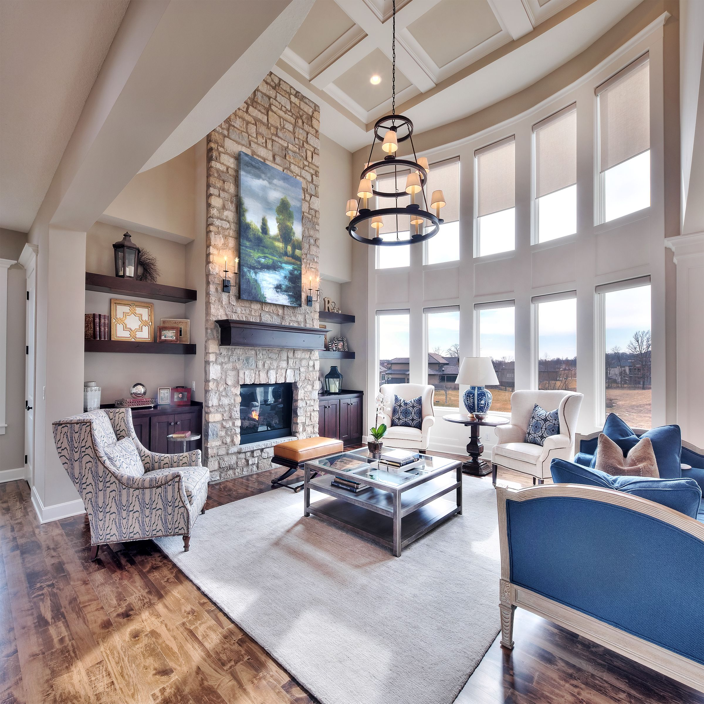 Floor To Ceiling Stone Fireplace With Huge Windows High Ceiling