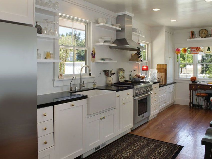 One Wall Kitchen With White Shaker Cabinets, Farmhouse Sink, Hardwood  Floors And Arabian Black Granite Counter