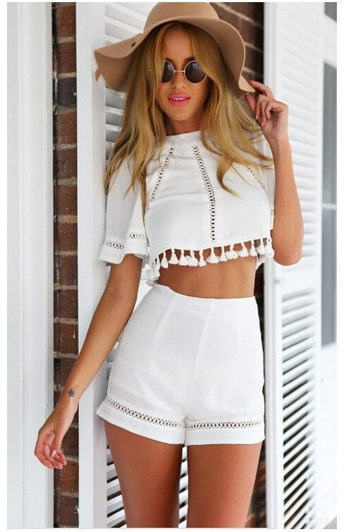 ee519c5111 A cute boho spin on a two piece short and crop top set! Complete with  peek-a-boo accents and tassel-ball detail, you'll not only love the belled  quarter ...