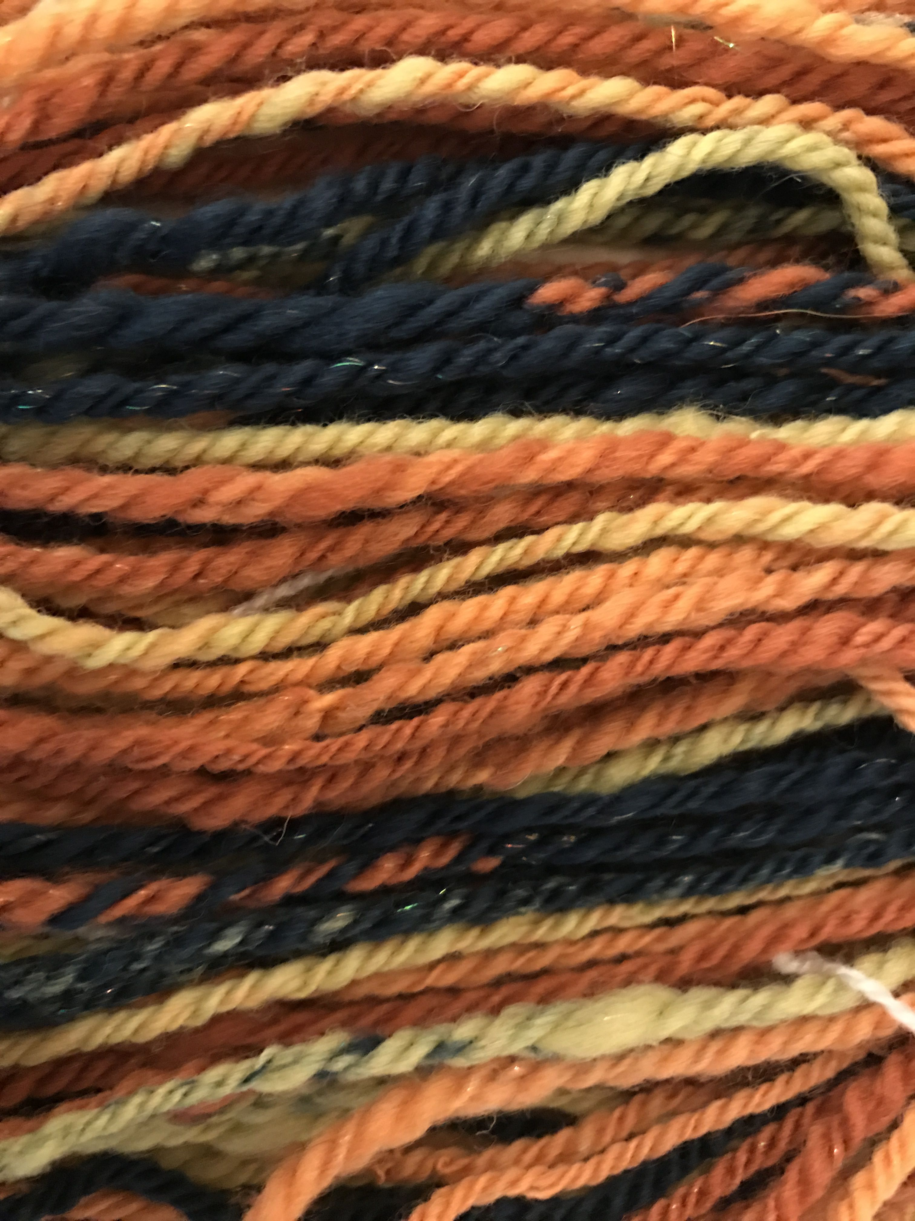 drumcarded striped batt, spun creating long colour repeats,navajo ply