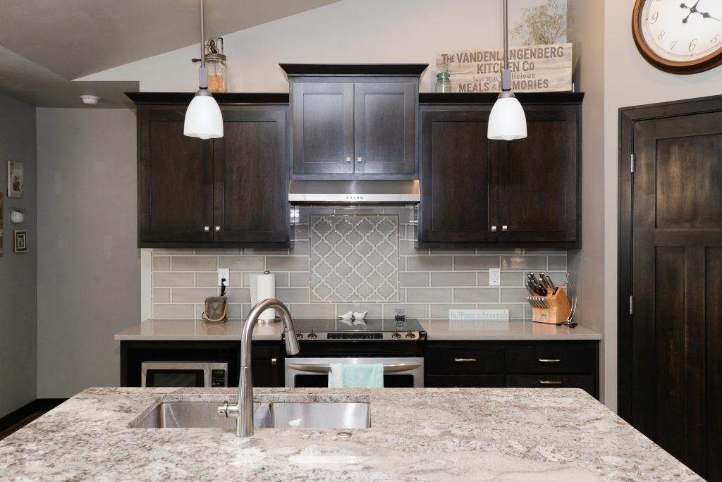 Light Gray Tiled Kitchen Backsplash With Light Gray Accent Tile