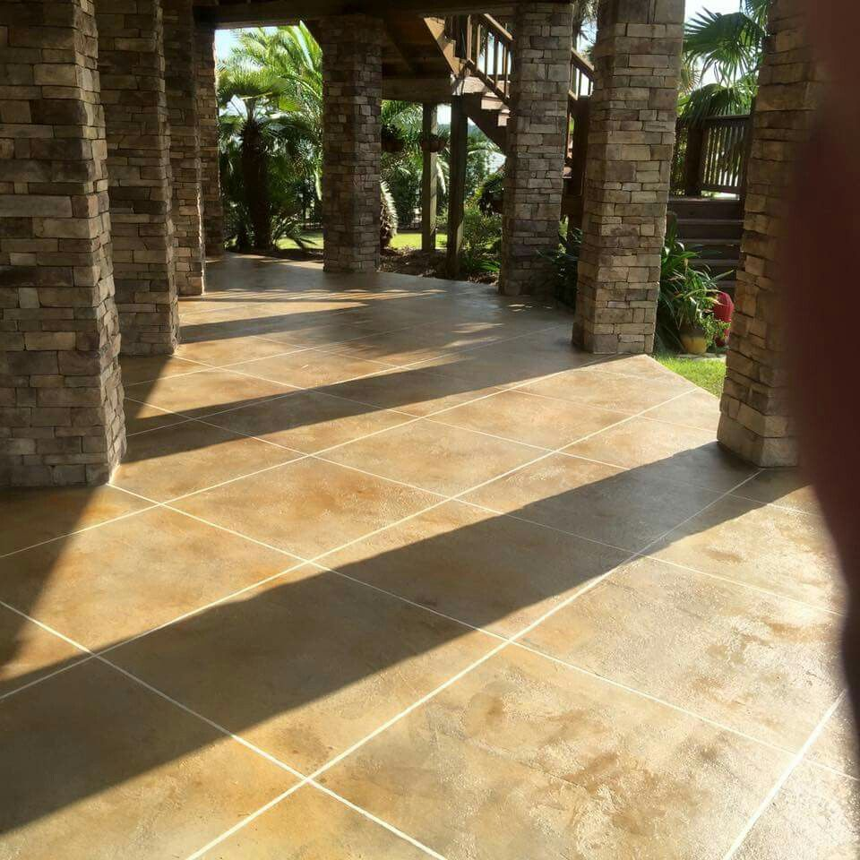 Hand troweled concrete overlay, tile pattern. Stained concrete ...