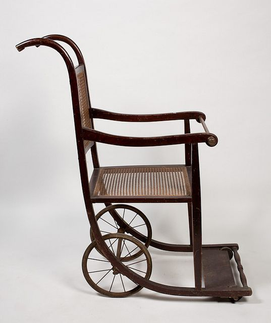 A Wheelchair With A Wooden Frame 198433 коляски
