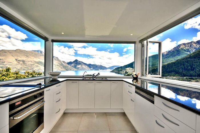 Modern Kitchen Window wow, look at the amazing view in this sleek and modern kitchen