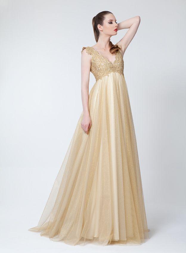 vestido corte imperio con cuerpo en v en guipur dorado y falda a