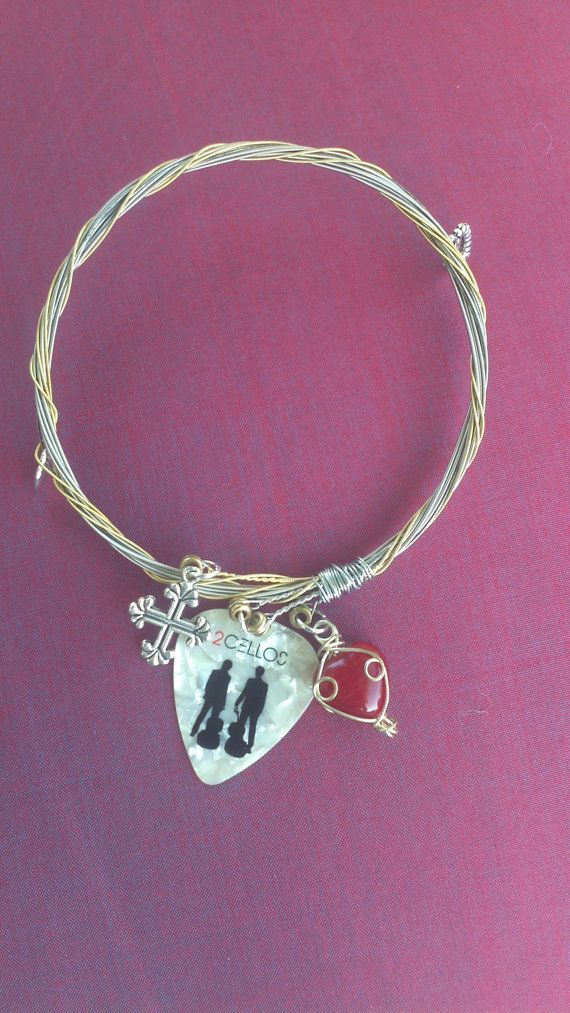2 Cellos Pick With Played Guitar String Bracelet By Famous Strings