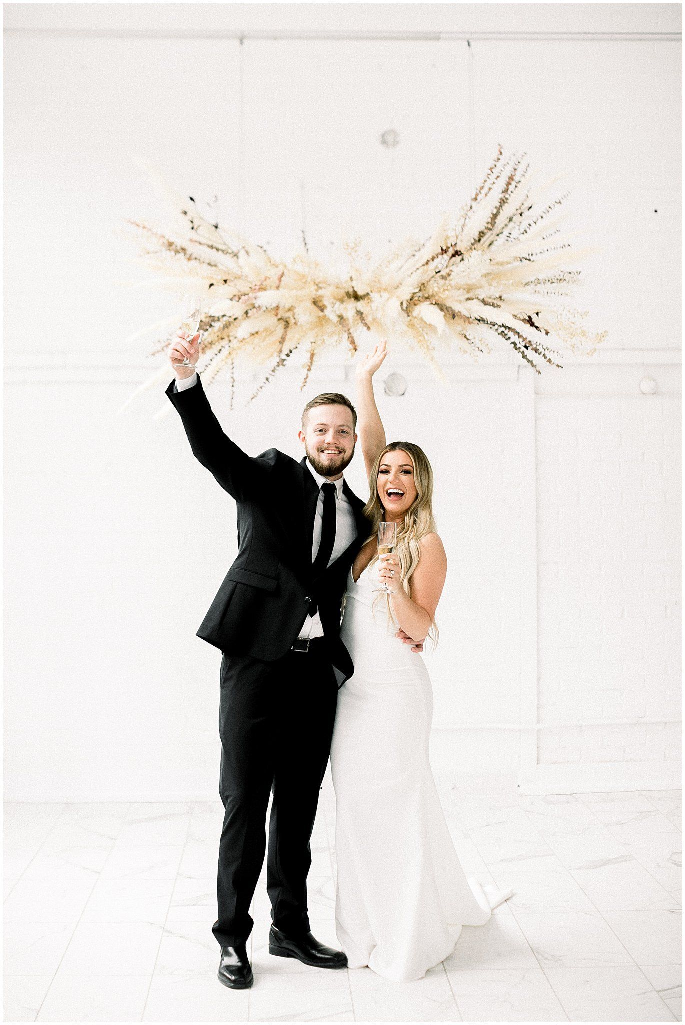 the driftless just married wedding photo idea pampas grass ceremony alter  cheers wedding picture