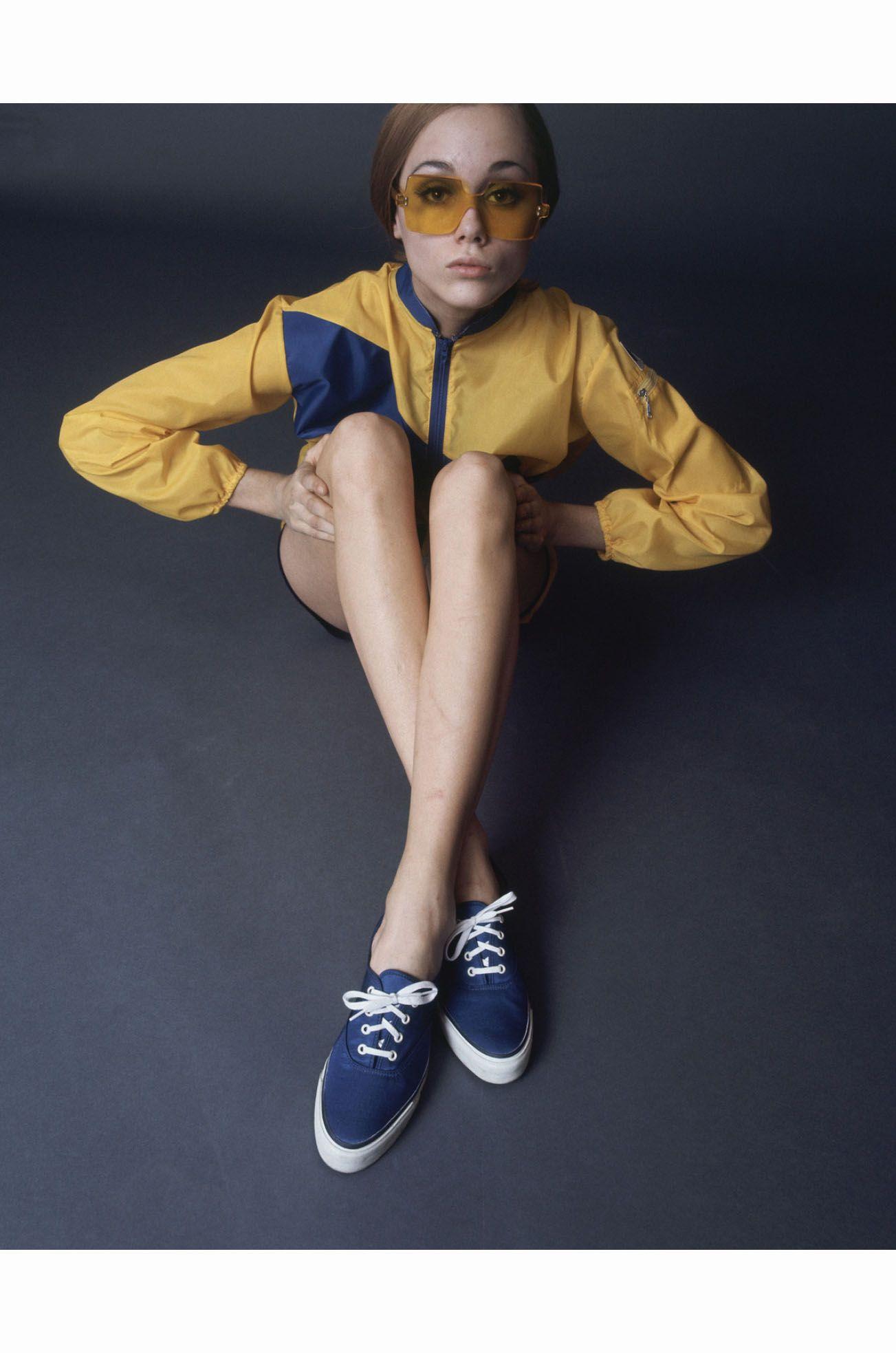 Model Jane Hitchcock wearing a bright yellow windbreaker