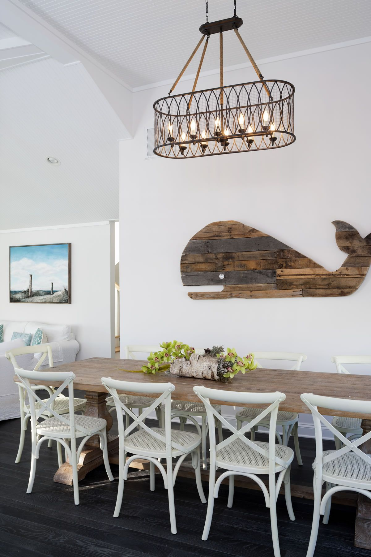 Wooden whale wall decor in a dining room. Beach house