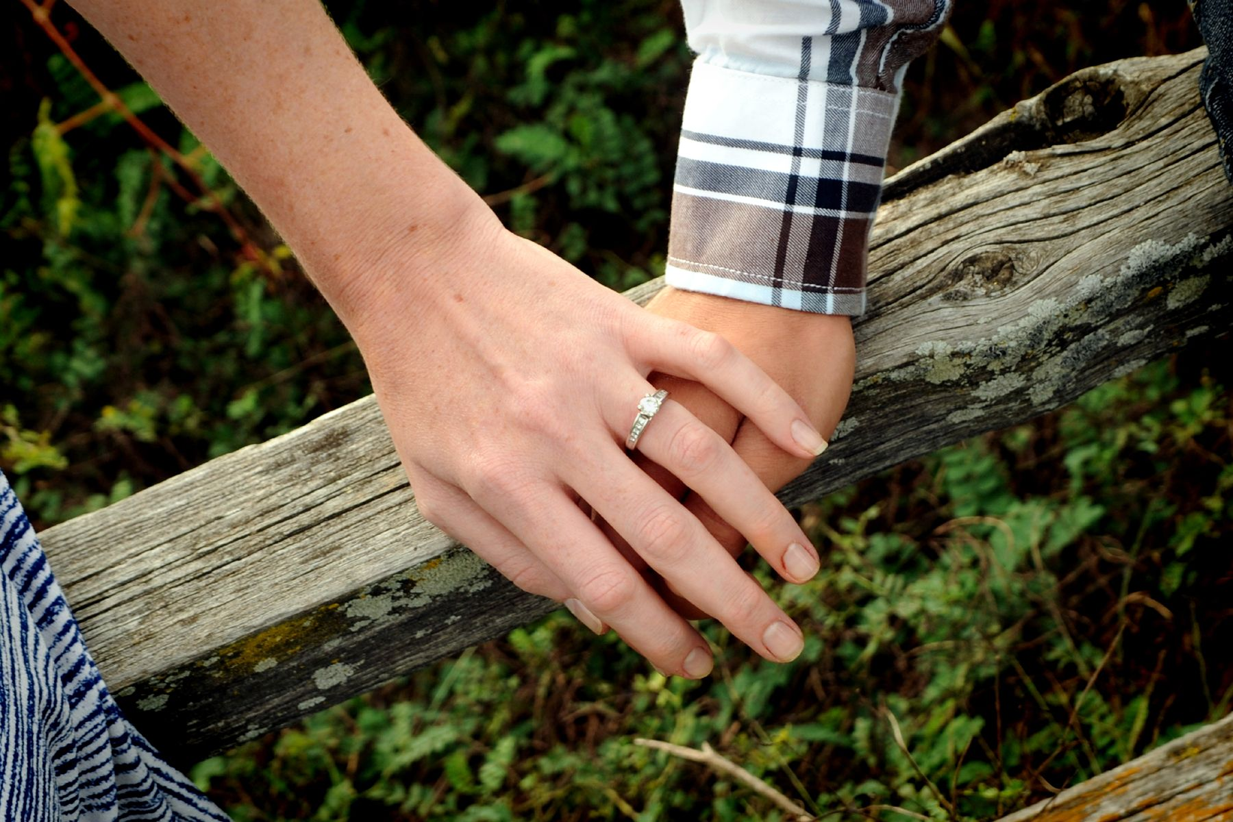 He put a ring on her finger wedding engagement photos
