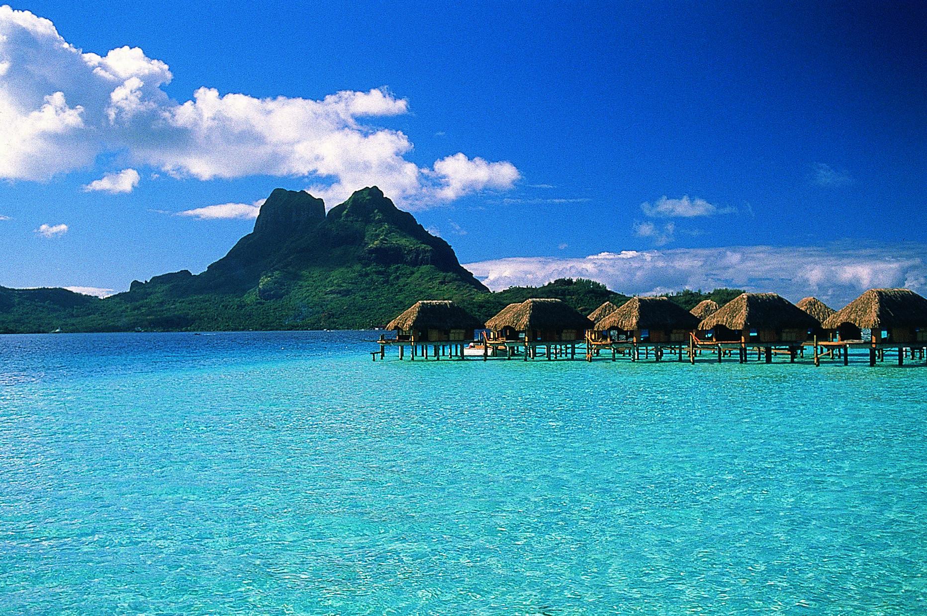 Lagoon And Bungalows At The Bora Pearl Beach Resort In Islands Of Tahiti