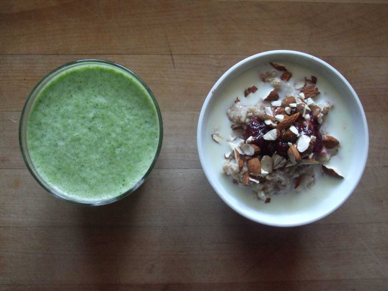 oatmeal with flax, soy milk, raspberry jam, and almonds, spinach smoothie with soy milk and cantaloupe