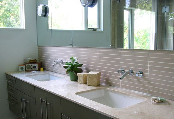 bungalow modern master bath - porcelain tile, jerusalem limestone countertop and Kohler wallmount faucets