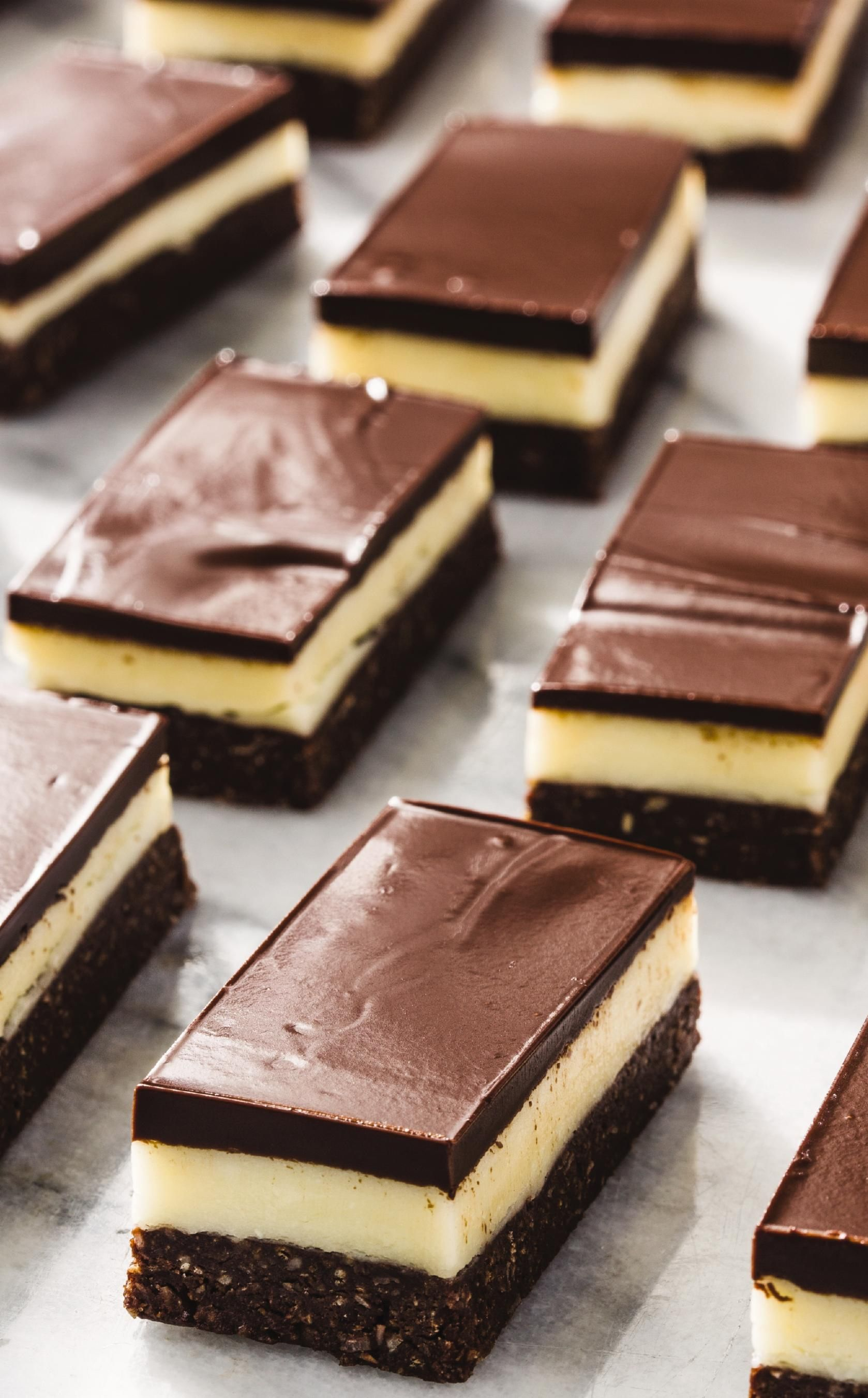 Nanaimo bars: A tri-layer treat of coconutty chocolate crust, creamy center, and dense, chocolate top are going to become your favorite no-bake dessert. #nanaimobars