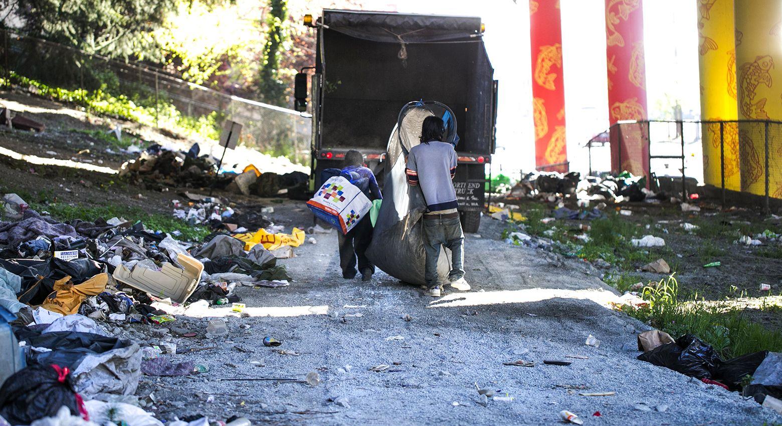 Seattle S Flawed Homeless Sweeps Campers Relocate Their Belongings Across S Jackson St As Maintenance Workers Clear Encampments Seattle News Homeless Sweep