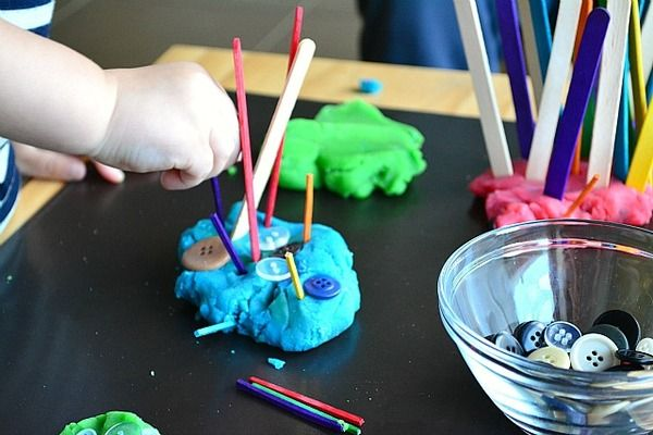 Toddler Art Activities: Finger paint, dot stickers, buttons and tongue depressor in play doh and a host of other media make for simple ways your infant or toddler can make art.