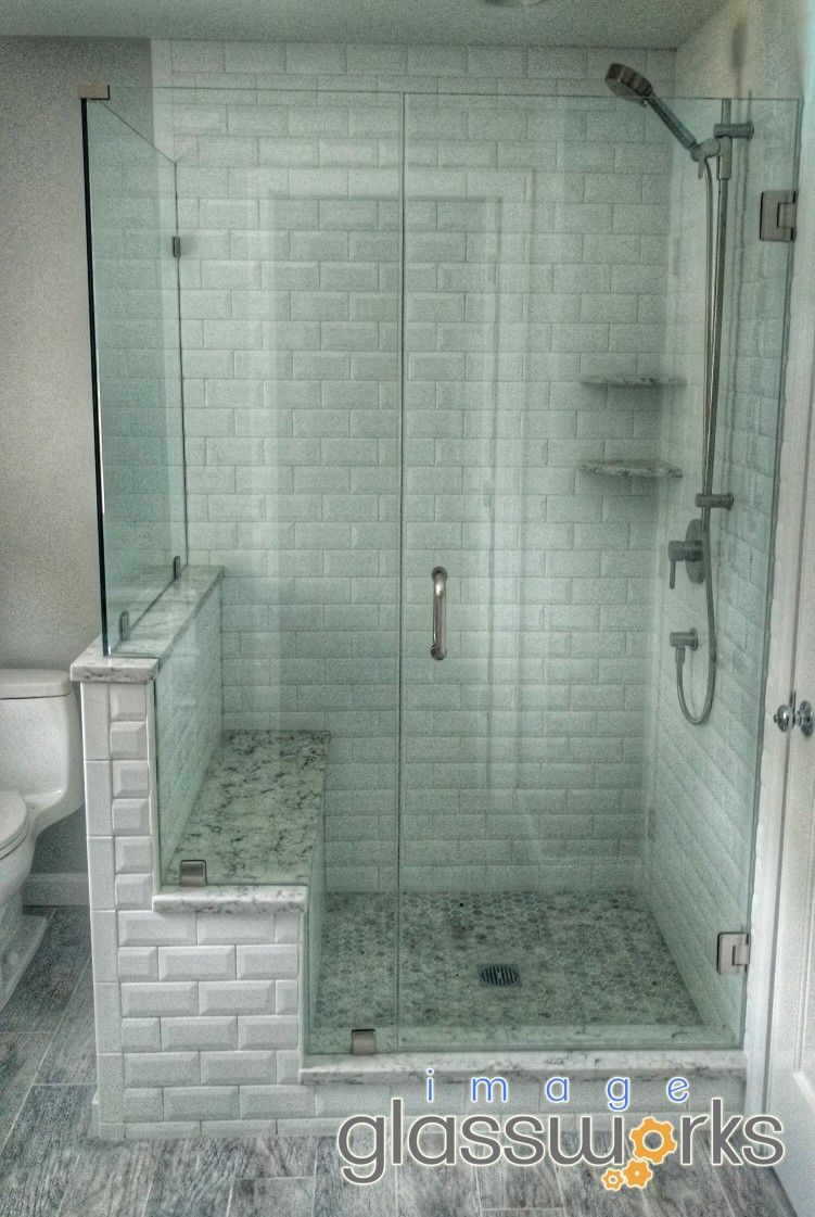 Incredibly beautiful frameless shower enclosure with a hinged door ...